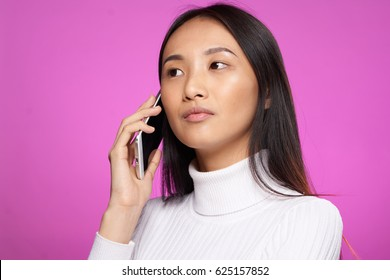 Portrait of a Japanese woman talking on the phone