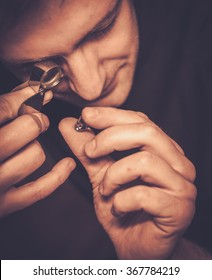 Portrait of a jeweler during the evaluation of jewels.
