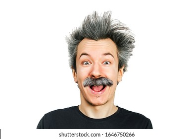 Portrait of jocular aging man with grey long hair smiling with open mouth, sticking his tongue out in Einstein manner. Isolated on background.