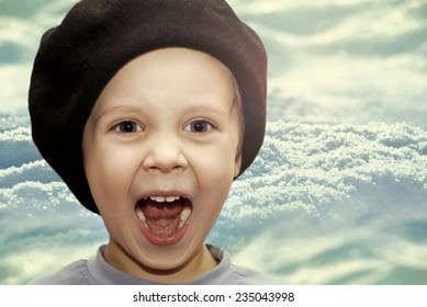 Portrait of joyful baby beret winter background.