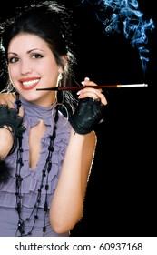 Portrait of a joyful brunette with cigarette holder