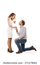 Portrait of joyful couple holding red heart isolated over white