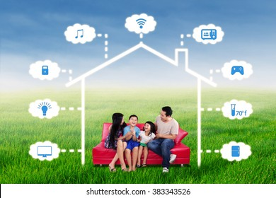 Portrait of joyful family having fun together on the sofa under a design of smart home technology system