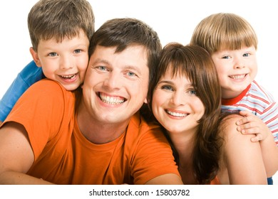 Portrait of joyful family laughing and looking at camera on white background