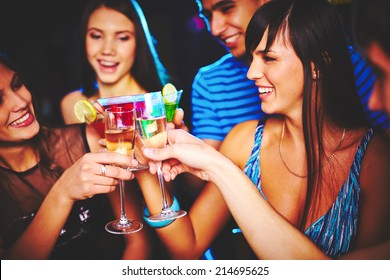 Portrait of joyful friends toasting at birthday party