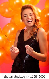portrait of joyful girl with sparkles against balloons