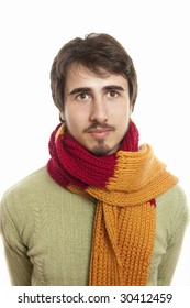 Portrait of a joyful young man wearing a scarf and green pullover against white background