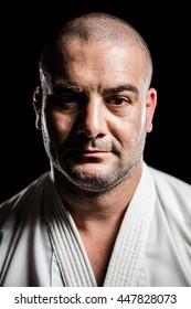 Portrait of karate fighter on black background