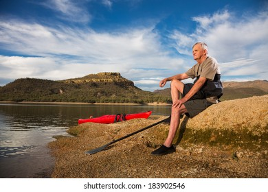 Portrait of Kayaker and Active Senior Man Taking a Restful Break.
