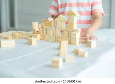 Portrait of kid cute asian boy playing a blocks wood game. selective focus. Copy space. Executive Functions Concept.