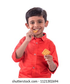 Portrait of kid eating a biscuit on white background