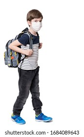 Portrait of kid with face mask holding school bag, isolated on white background