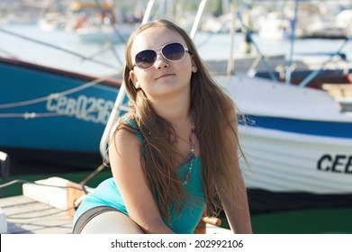 Portrait of kid girl on the pier closeup
