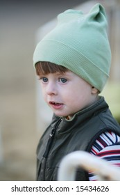 Portrait of the kid in a knitted cap
