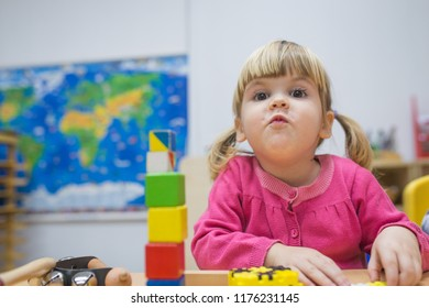 Portrait of kid playing with colorful toys