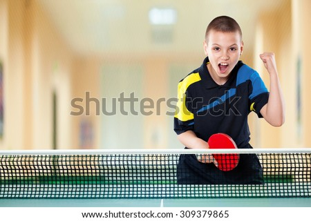 Portrait Of Kid Playing Tennis celebrating flawless victory in table tennis