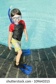 Portrait of a kid with swimwear ready to swim