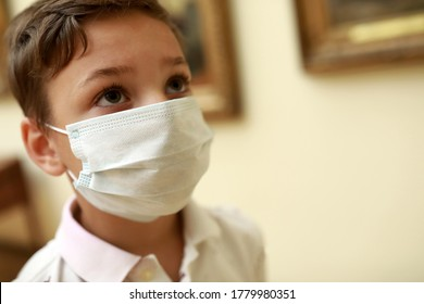 Portrait of kid wearing medical protection mask in museum