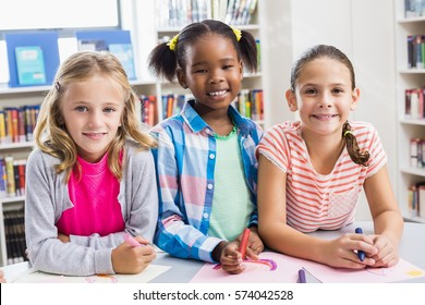 Portrait of kids smiling in library