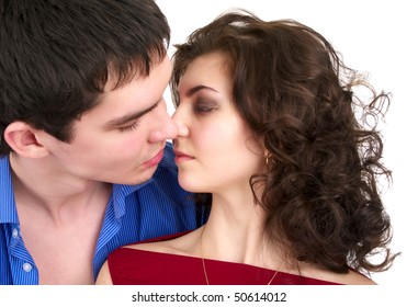 Portrait of kissing beautiful sexual couple isolated over white background