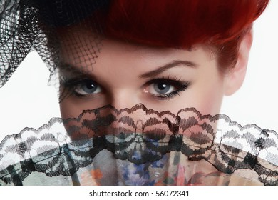 Portrait of lady eyes with hand fan and lashes! Isolated on white background!