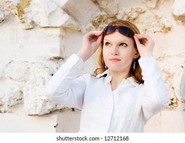 Portrait lady taking sun glasses off
