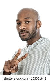 Portrait of a late 20s handsome black man making peace sign isolated on a white background