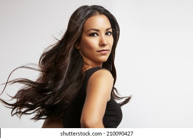 portrait of a latin woman with blowing windy hair
