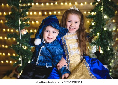 portrait of laughing boy and girl at chritmas studio