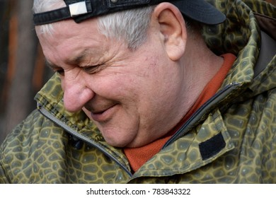portrait of a laughing Caucasian old man