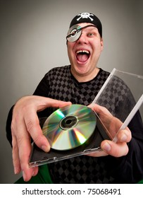 Portrait of laughing information pirate with computer disk