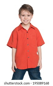 A portrait of a laughing little boy in a red shirt on the white background