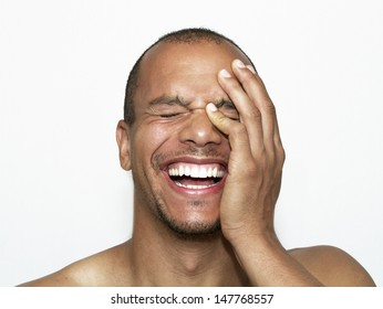 Portrait of a Laughing Man with his hand on his face