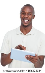 Portrait of a laughing man with tablet pc on a white background