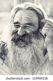 portrait of  laughing old man with gray beard