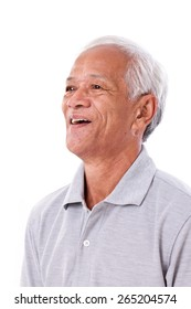 portrait of laughing senior man looking up