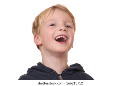 Portrait of a laughing young boy on white background