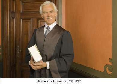 Portrait of a lawyer holding a book and smiling