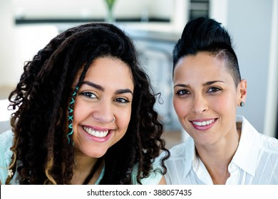 Portrait of lesbian couple smiling at camera