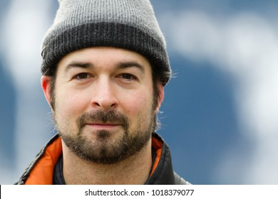 portrait likeable man wearing winter cap