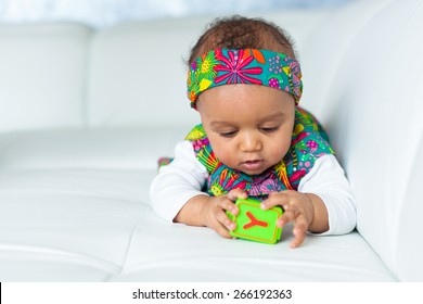 Portrait of little African American little girl playing - Black people