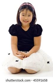 Portrait of little Asian ballet girl  - isolated over white