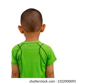 Portrait a Little Asian boy, cutting hair skinhead, wearing a green T-shirt, Standing turned his back. Action cute isolated on white background