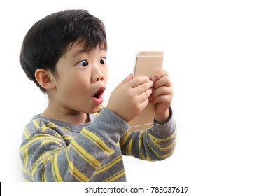 Portrait of a little Asian boy looking extremely surprised with his mouth open and hands holding a smartphone