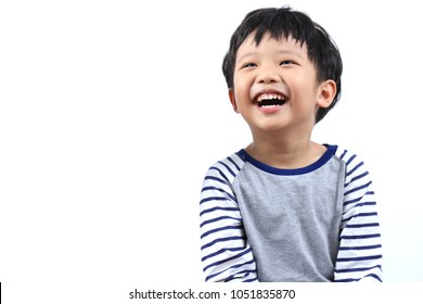 Portrait of a little Asian boy smiling and eye looking up, isolated on white background.