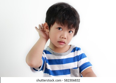 Portrait of a little asian boy suffers from hearing impairment, hard of hearing, hearing loss, acoustic or ear problem.