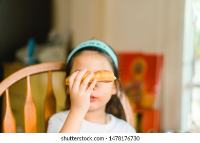 Portrait of Little asian girl child hand cover and close her mouth and face with no appetite in front of the meal.Concept of loss of appetite.