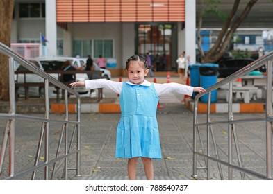 Portrait of little Asian girl in school uniform