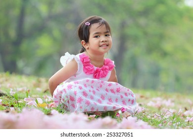 Portrait, Little asian girl was smiling and playing happily in the park