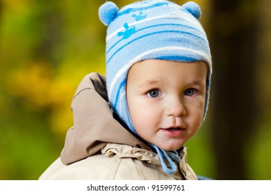 Portrait of little baby boy in the park